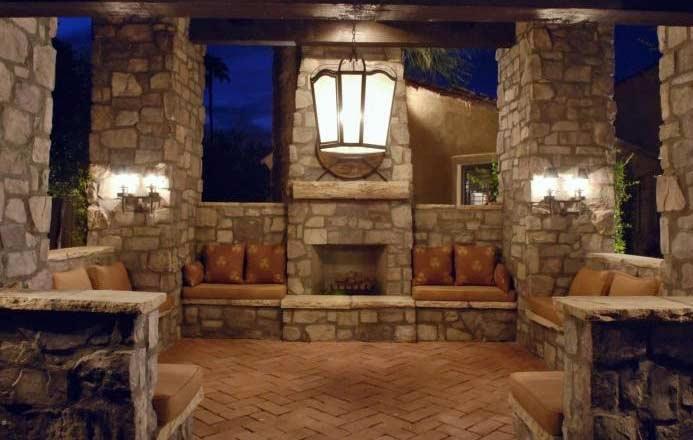 Florida custom home builders orlando fl Outdoor room with fireplace